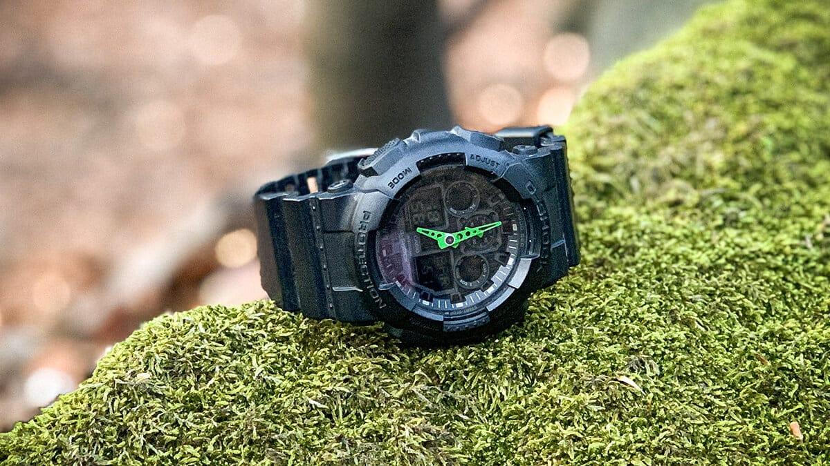 Matné hodinky Casio G-Shock GA-100-1A3 se zelenými ručičkami